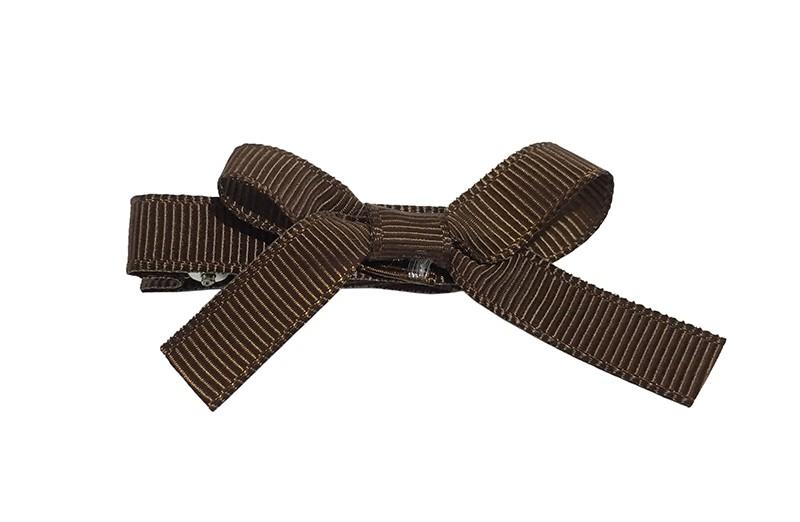 Leuk haarknipje bekleed met bruin lint. Met daarop een vrolijk strikje van bruin lint. Het knipje is een alligator haarknipje van ongeveer 4 centimeter.