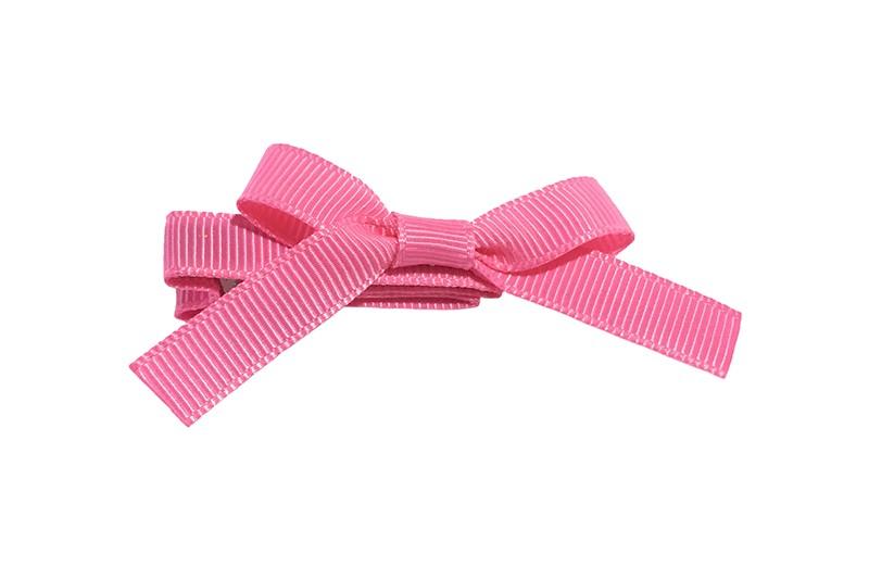 Leuk haarknipje bekleed met fel roze lint. Met daarop een vrolijk strikje van fel roze lint. Het knipje is een alligator haarknipje van ongeveer 4 centimeter.