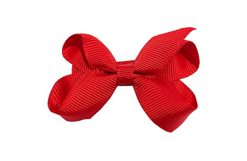 Lief haarknipje met een mooi strikje van rood geribbeld lint. In een schattig middelgroot maatje. Op een plat haarknipje bekleed met hetzelfde rode lint.