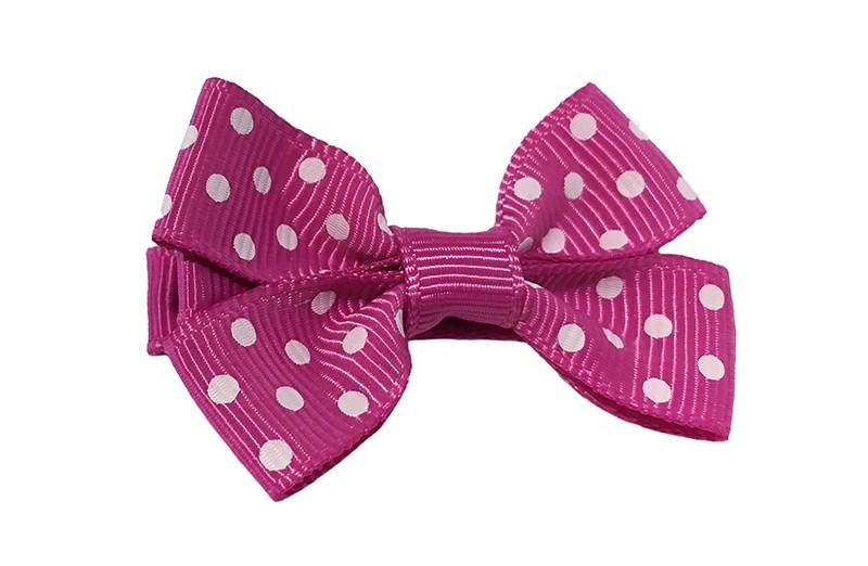 Leuk roze haarstrikje met witte stippeltjes. Van geribbeld lint.  Op een platte haarknip van ongeveer 4.5 centimeter bekleed met roze lint.