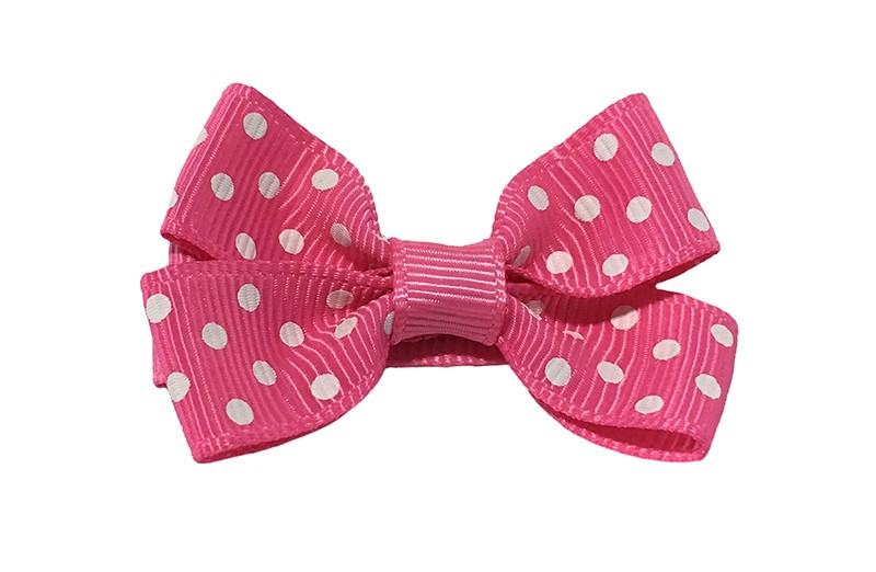 Leuk fel roze haarstrikje met witte stippeltjes. Van geribbeld lint.  Op een platte haarknip van ongeveer 4.5 centimeter bekleed met roze lint.