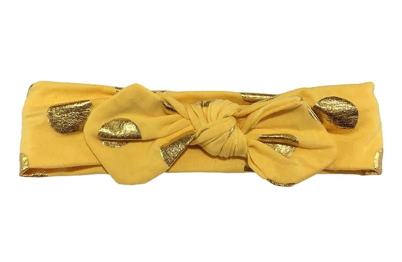 Leuk geel meisjes haarbandje (peuter, kleuter) met glanzend gouden stippen. Dit haarbandje is van zachte rekbare stof, geknoopt in 'konijnenoortjes'
