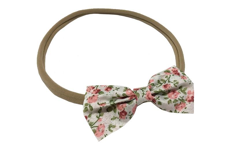 Schattig nylon baby haarbandje. Met een strikje met vrolijk roze groen bloemenprintje.  Het strikje is ongeveer 7 centimeter.
