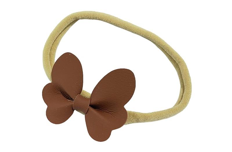 Schattig nylon peuter kleuter haarbandje.  Met een bruin leren vlindertje.  Het haarbandje is van dun goed rekbaar nylon daardoor geschikt vanaf ongeveer 1 tot 6 jaar.