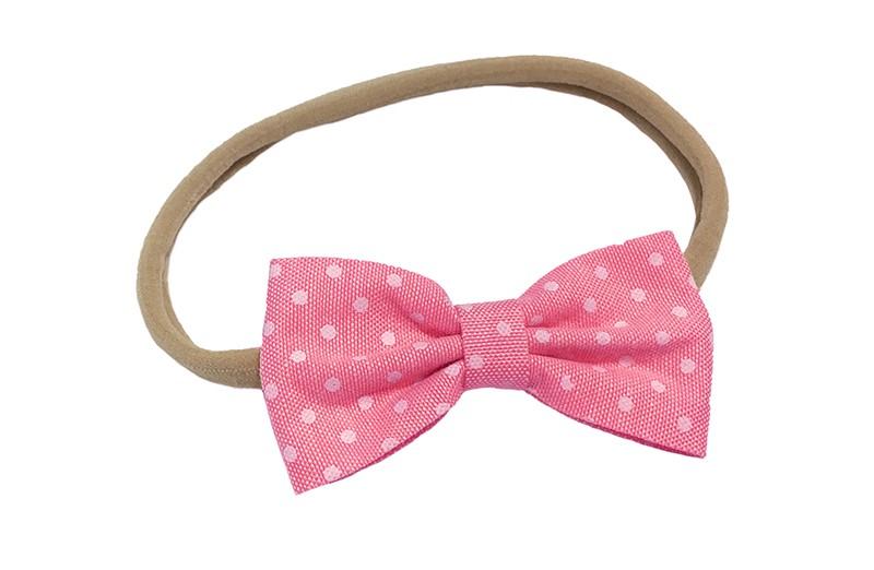 Vrolijk baby, peuter, meisjes haarbandje van zacht nylon. Met daarop een licht roze strikje met witte stippeltjes.  Het strikje is ongeveer 7 centimeter.  Het haarbandje is rekbaar en daardoor te gebruiken voor de kleintjes en ook grotere meisjes.