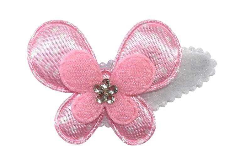 Schattig wit fluffie peuter haarspeldje. Met een licht roze gestipplde vlonder en een effen licht roze vlindertje.  Afgewerkt met een klein glinster bloemetje.