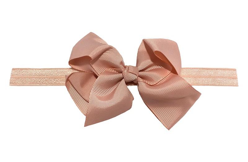 Vrolijk zalmroze peuter, meisjes haarbandje. Het bandje is van goed rekbaar elastiek daardoor geschikt tot ongeveer 4 jaar.  Met een mooie grote zalmroze strik.