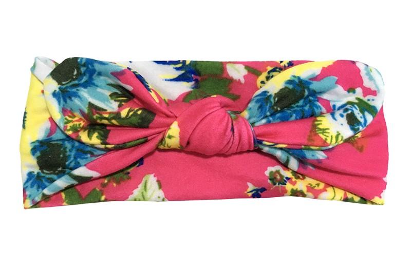 Vrolijk roze geknoopt baby peuter haarbandje.  Met bloemendessin in blauw, geel en groen tinten.  Het haarbandje is van een zachte iets rekbare stof.  Geschikt tot en met ongeveer 2,5 jaar.