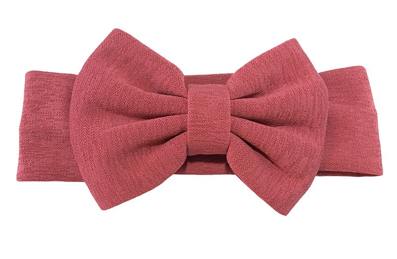 Vrolijke donkerroze rode stoffen baby peuter meisjes haarband. Van rekbare stof met een grote stoffen strik. De strik is ongeveer 12 centimeter breed.