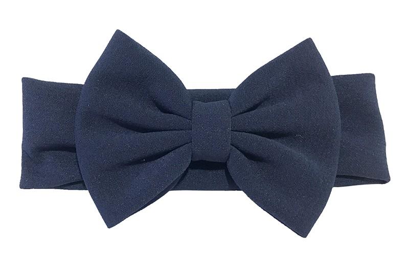 Vrolijke donkerblauw stoffen baby peuter meisjes haarband.  Van rekbare stof met een grote stoffen strik. De strik is ongeveer 12 centimeter breed.
