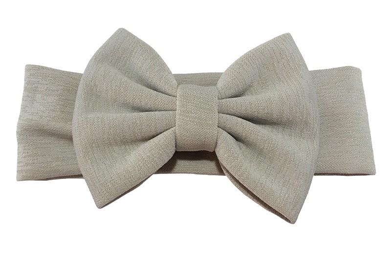Vrolijke licht grijs stoffen baby peuter meisjes haarband.  Van rekbare stof met een grote stoffen strik. De strik is ongeveer 12 centimeter breed.