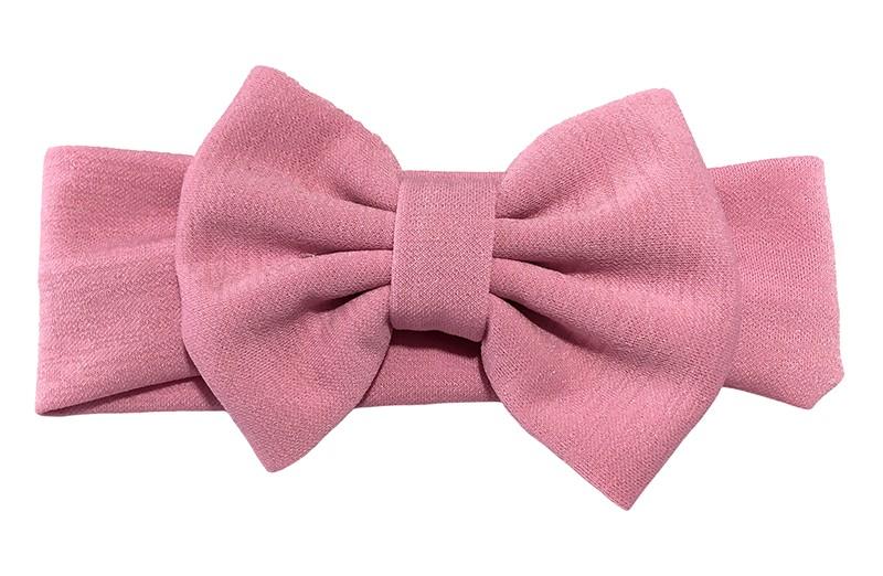Vrolijke licht roze stoffen baby peuter meisjes haarband.  Van rekbare stof met een grote stoffen strik. De strik is ongeveer 12 centimeter breed.