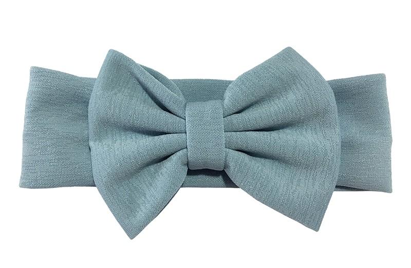 Vrolijke licht blauw stoffen baby peuter meisjes haarband.  Van rekbare stof met een grote stoffen strik. De strik is ongeveer 12 centimeter breed.