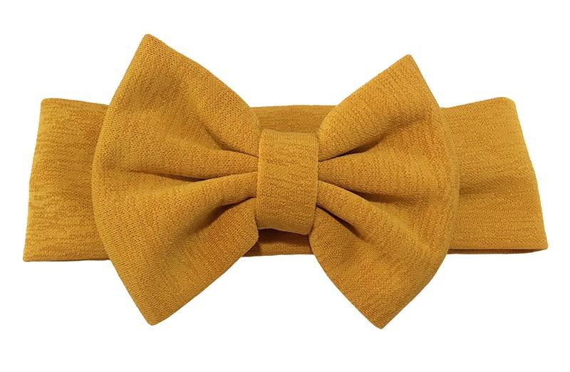 Vrolijke oker gele stoffen baby peuter meisjes haarband. Van rekbare stof met een grote stoffen strik.