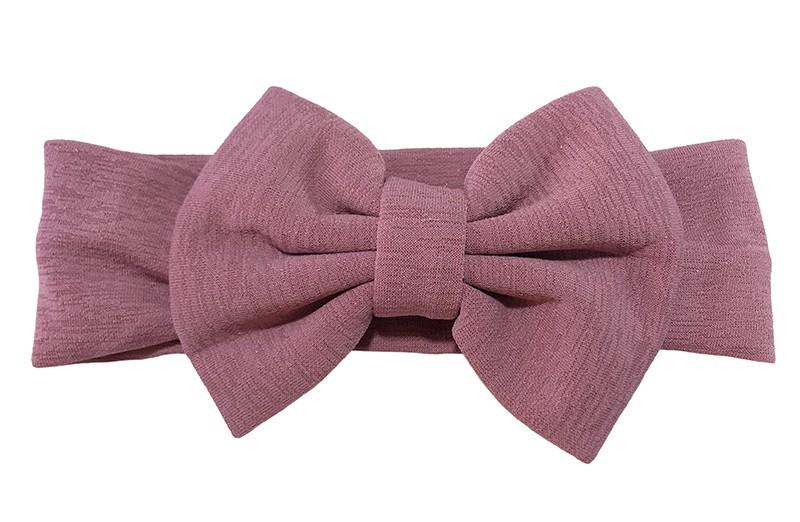 Vrolijke paars roze stoffen baby peuter meisjes haarband. Van rekbare stof met een grote stoffen strik. De strik is ongeveer 12 centimeter breed.