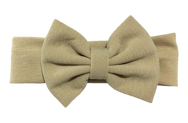 Vrolijke zand kleurige stoffen baby peuter meisjes haarband.  Van rekbare stof met een grote stoffen strik. De strik is ongeveer 12 centimeter breed.