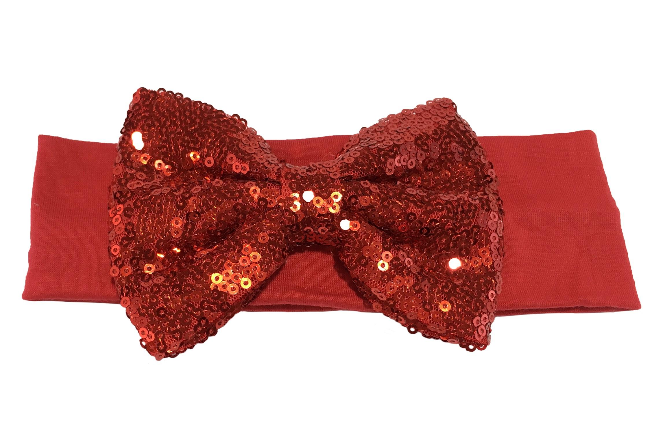 Leuke rode stoffen baby, peuter, meisjes haarband.  Van zachte rekbare stof.  Met een grote rode strik met pailletjes van ongeveer 11 centimeter breed. Niet uitgerekt is het haarbandje ongeveer 18 centimeter en 5.5 centimeter breed.