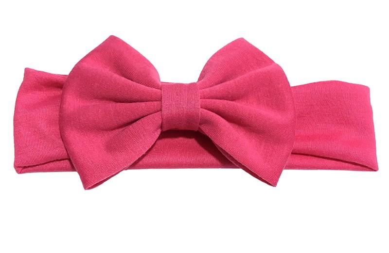 Schattige fuchsia roze baby peuter haarband van rekbare stof met een grote stoffen strik.