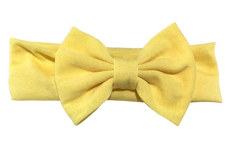 Schattige licht gele baby peuter haarband van rekbare stof met een grote stoffen strik.
