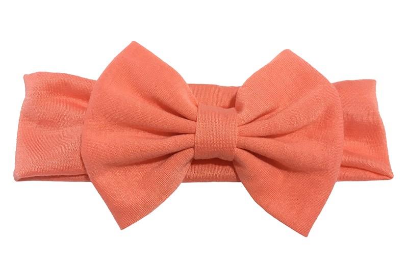 Schattige licht oranje peuter, meisjes haarband van rekbare stof met een grote stoffen strik.