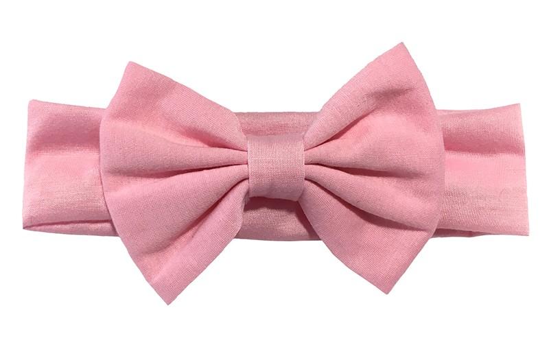Schattige roze baby peuter haarband van rekbare stof met een grote stoffen strik.
