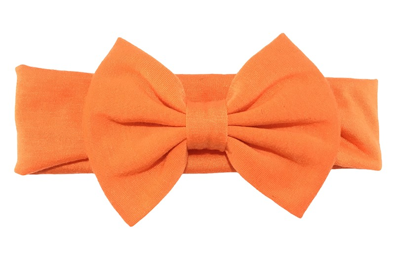 Schattige oranje peuter meisjes haarband van rekbare stof met een grote stoffen strik.