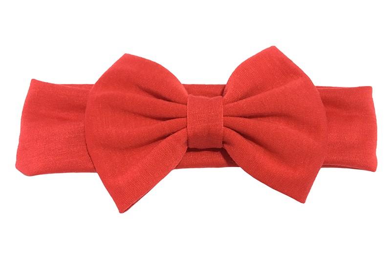 Schattige rode baby peuter haarband van rekbare stof met een grote rode stoffen strik. Het bandje is ongeveer 4 centimeter breed en de strik is ongeveer 12 centimeter breed.