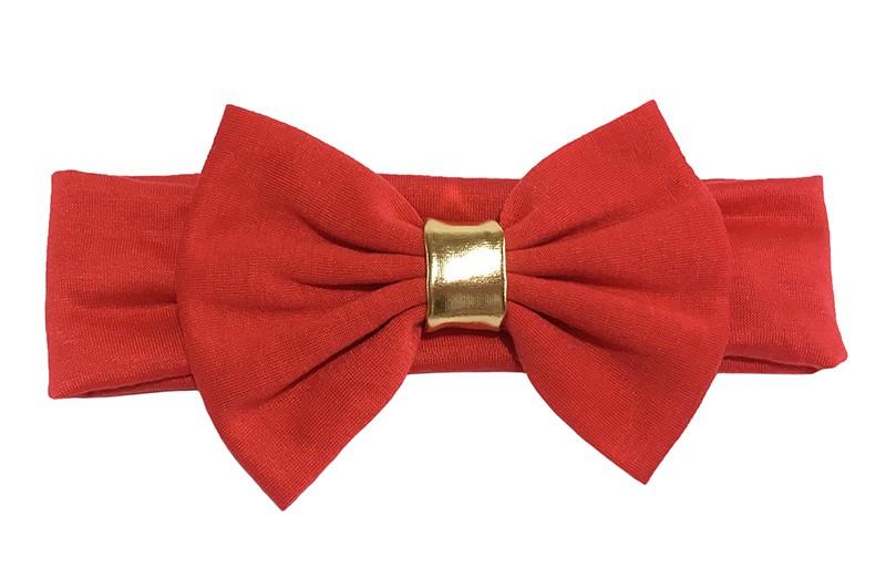 Schattige rode baby haarband van rekbare stof. Met een grote rode stoffen strik en een goudkleurig bandje.