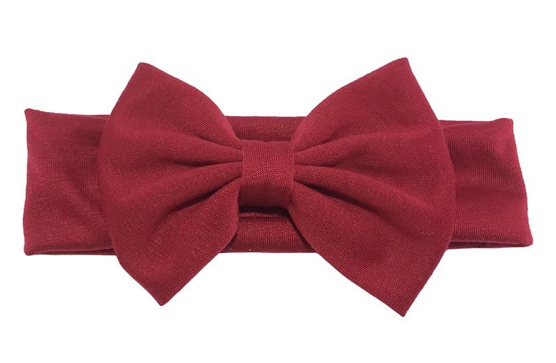 Schattige rode baby peuter haarband van rekbare stof met een grote stoffen strik.