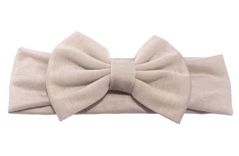 Schattige zand kleurige baby peuter haarband van rekbare stof met een grote stoffen strik.