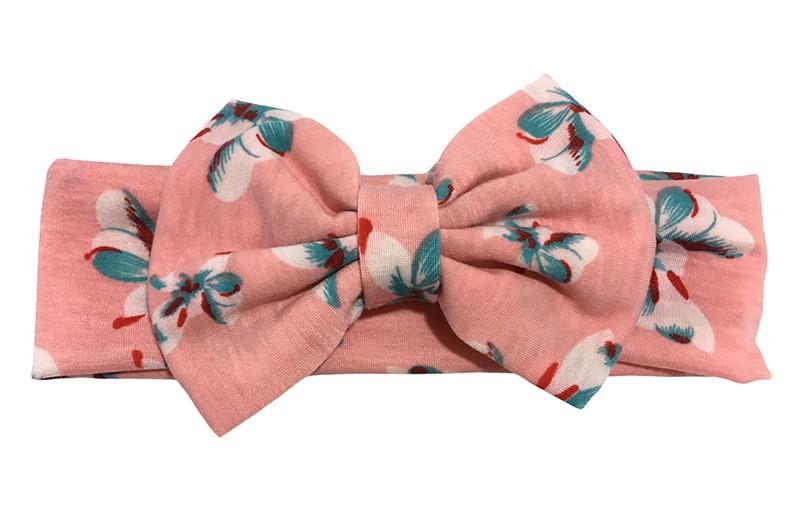 Vrolijke zalmroze peuter, kleuter meisjes haarband met blauw witte bloemetjes motiefjes. Deze haarband is van zachte rekbare stof.  Met een grote stoffen strik van ongeveer 8 centimeter hoog.