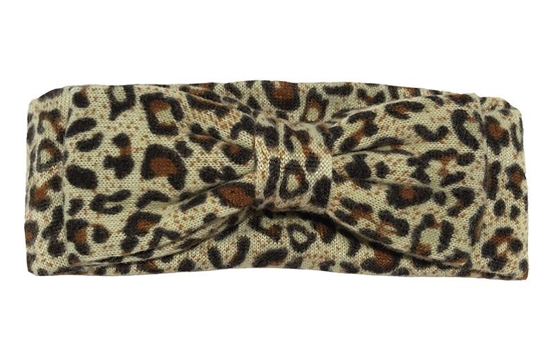 Leuke bruine stoffen baby peuter haarband met luipaarddessin en vrolijke stippeltjes.  Van lekker zachte rekbare stof. Met een grote stoffen strik.  De breedte/hoogte van het haarbandje is 6.5 centimeter.  De strik van het haarbandje is 13.5 centimeter.