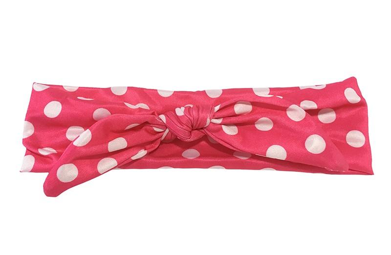 Leuk fuchsia roze baby, peuter, meisjes knoop haarbandje. Met vrolijke witte stippen. Dit haarbandje is van glanzende rekbare stof.  Het haarbandje is ongeveer 5.5 centimeter breed.  Niet uitgerekt is het haarbandje ongeveer 19 centimeter.