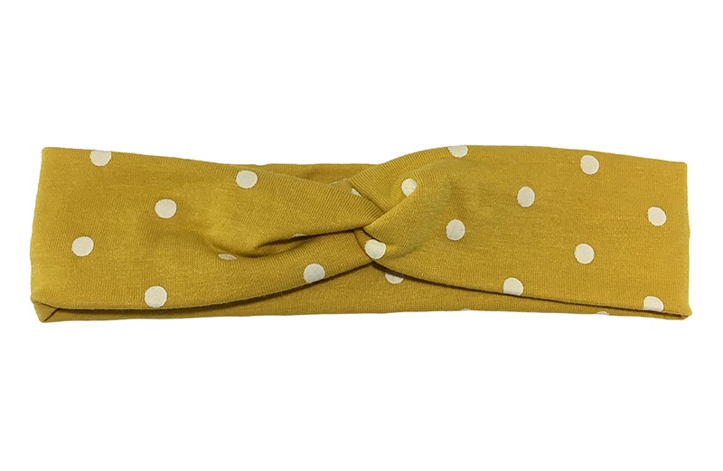 Leuk (budget) mosterd geel stoffen baby, peuter haarbandje in twist model met witte stippen. rnVan dunne rekbare stof, geschikt tot ongeveer 2 jaar. rn