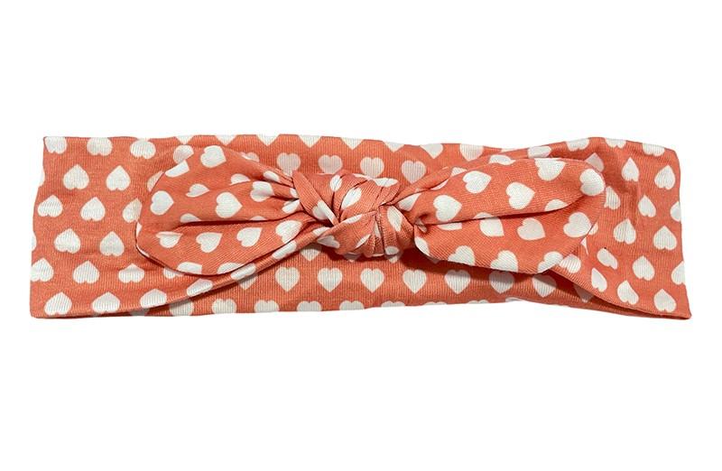 Schattig licht oranje stoffen baby peuter haarbandje. Met kleine witte hartjes patroontje.  Het haarbandje is van zachte licht rekbare stof.  Geschikt tot en met ongeveer 1.5 a 2 jaar.