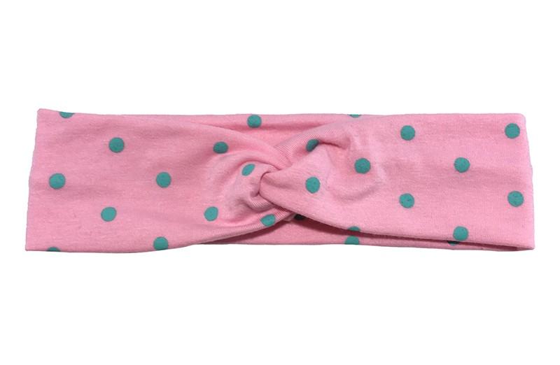 Leuk (budget) licht roze stoffen baby, peuter haarbandje in twist model met licht groene stippen.  Van dunne rekbare stof, geschikt tot ongeveer 2 jaar.