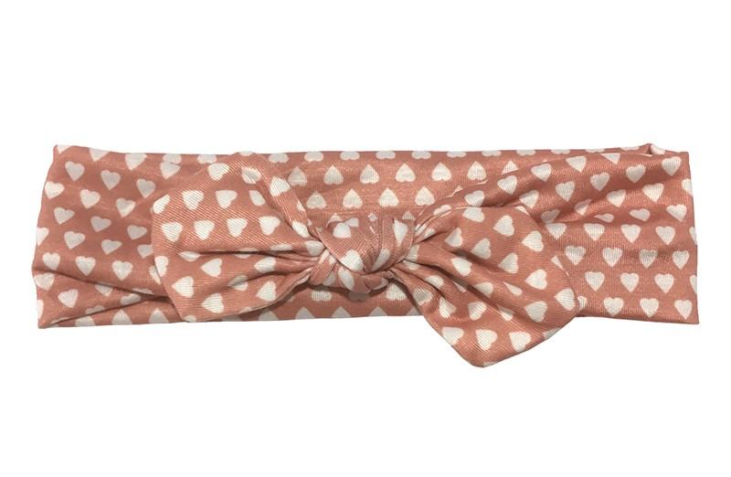 Schattig (oud) roze baby peuter haarbandje met witte hartjes.  Het haarbandje is van zachte rekbare stof, geknoopt in een leuk modelletje.