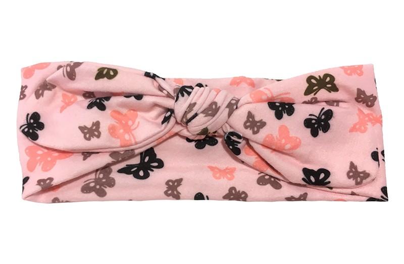 Leuk geknoopt baby, peuter, meisjes haarbandje. Van zachte roze stof met een vlindermotiefjes in verschillende kleuren. Dit haarbandje is van zachte, goed rekbare stof. Zo kun je lang plezier hebben van dit leuke haarbandje. Het haarbandje is ongeveer 7 centimeter breed.