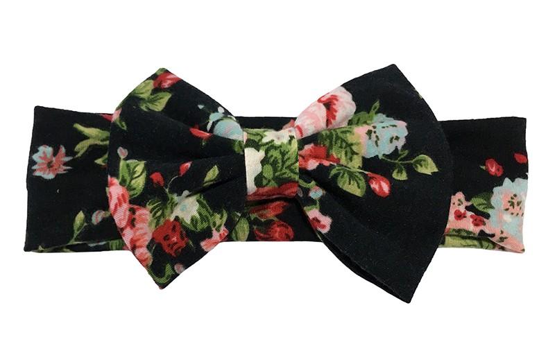 Vrolijke zwart stoffen baby peuter haarbandje met rood en roze bloemmotiefjes.  Met een grote stoffen strik van dezelfde vrolijke stof.  Het bandje is van rekbare zachte stof ongeveer 5 centimeter breed.