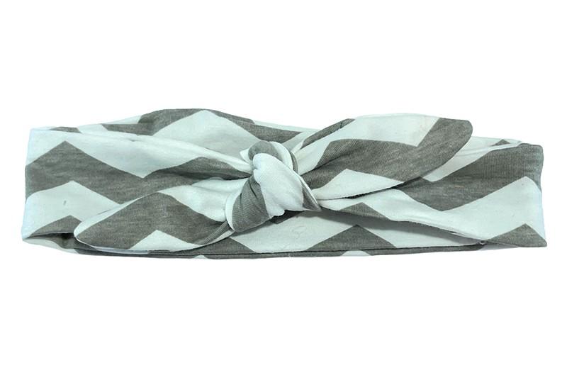 Schattig stoffen peuter kleuter meisjes haarbandje. Met vrolijke grijs en witte zigzag strepen.  Het haarbandje is van rekbare stof, makkelijk zelf te knopen. Zo kun je lang plezier hebben van dit leuke haarbandje.