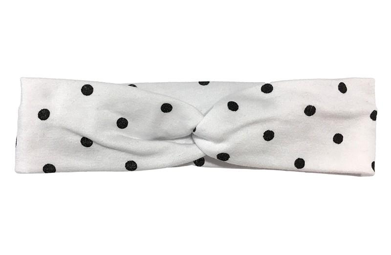 Leuk (budget) wit stoffen baby, peuter haarbandje in twist model met zwarte stippen.  Van dunne rekbare stof, geschikt tot ongeveer 2 jaar. rn