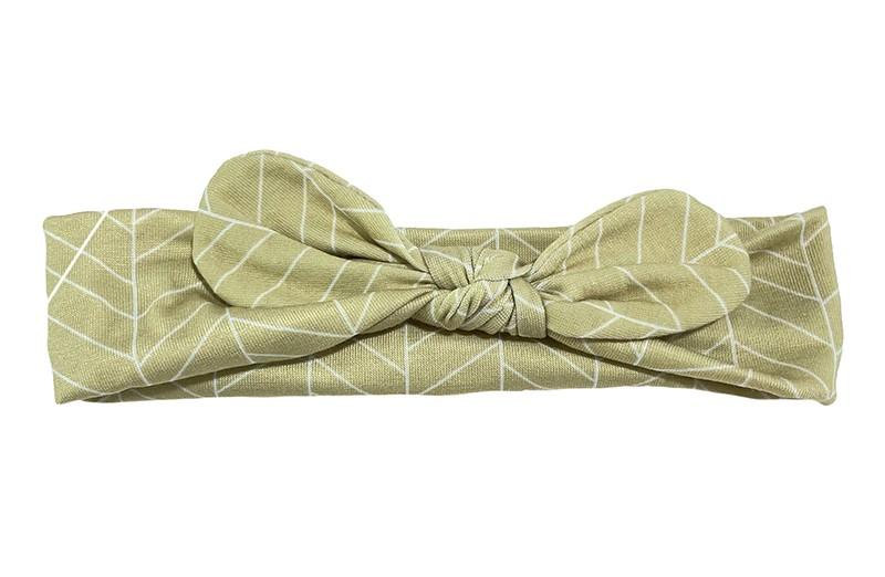 Schattig zandbruin stoffen baby peuter haarbandje.  Met een vrolijk wit lijntjes patroontje.  Het haarbandje is van rekbare gladde stof. Geknoopt in een leuk modelletje. Geschikt tot en met ongeveer 2 a 3 jaar.