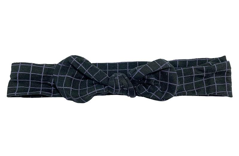 Stoer zwart stoffen peuter kleuter meiden haarbandje.  Met paarse lijntjes. Geknoopt in een leuk modelletje. Het haarbandje is van goed rekbare zachte stof.  Geschikt tot en met ongeveer 10 jaar.