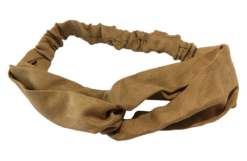 Leuk meiden dames twist haarbandje camel bruin. Van mooie suedelook stof met een goed rekbaar gedeelte.  Het haarbandje is geschikt voor meisjes vanaf ongeveer 7 jaar, grotere meiden, tieners tot aan dames.