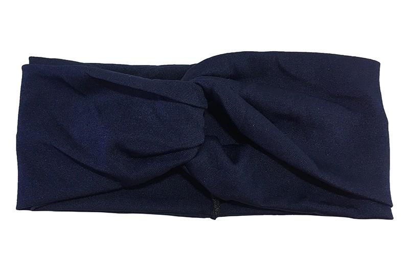 Hip Donker blauw effen twist haarbandje.  Het haarbandje is van gladde goed rekbare stof, geschikt voor grotere meisjes, tieners en dames.