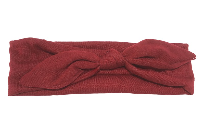 Lief effen (donker) rood baby peuter haarbandje van zachte rekbare stof. In een leuk modelletje geknoopt.  Het haarbandje is ongeveer 5 centimeter breed.