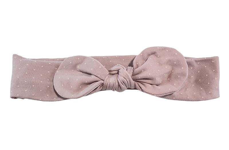 Vrolijk oudroze zacht stoffen peuter kleuter en meiden haarbandje. Met kleine licht gekleurde stipjes.  Het haarbandje is van goed rekbare zachte stof.  Geschikt tot en met ongeveer 10 jaar.