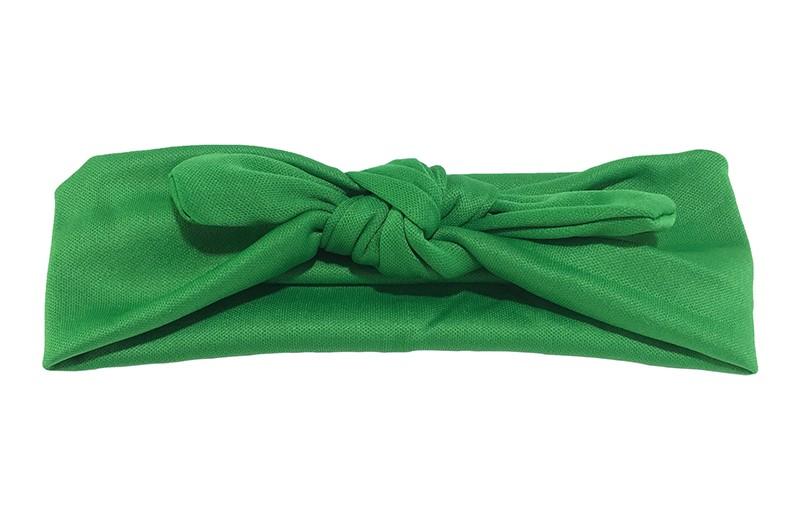 Leuk groene baby peuter haarbandje van glanzende rekbare gladde stof. Het haarbandje is in een leuk 'konijnenoortjes model' geknoopt.  De hoogte van het haarbandje is ongeveer 5 centimeter.