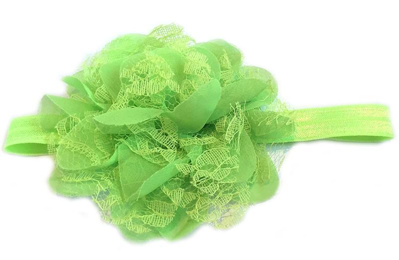 Leuke fel groene peuter / kleuter haarband met mooie licht groene bloem van stof en kant.