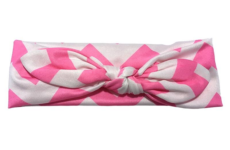 Vrolijk licht roze wit baby peuter haarbandje van gladde rekbare stof met zigzag strepen. Geknoopt in leuk 'konijnenoortjes model' De hoogte van het haarbandje is ongeveer 6 centimeter.